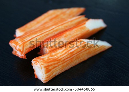 japan surimi artificial crab isolated on black background