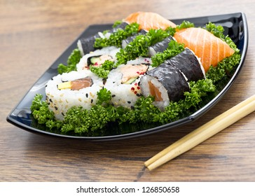 japan sushi in black plate on wooden table