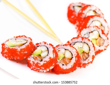 Japan sushi roll with salmon caviar isolated on white