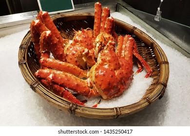 Japan Taraba crabs in basket on ice in market