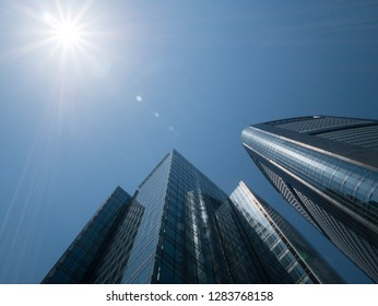 Japan, Tokyo - April 22, 2018: Skyscrapers raising up into the sky to the sun rays on a sunny day