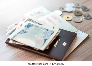 Japan, Tokyo - August 29 2019: Wads of Japanese banknote, Foreigner passport, Metro map, Pasmo card and small coins laying on table. Travel in Japan, Currency, Yen, Tokyo 2020, VAT refund, Tax free.