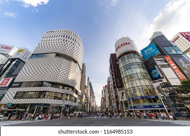 JAPAN, TOKYO, Ginza – August 2018: Landmark of Ginza. Ricoh's Ginza Electronic Billboard. Pedestrian crossing the street. Pedestrian Heaven. Shopping at Ginza, Tokyo. Wide Angle HDR Shot.