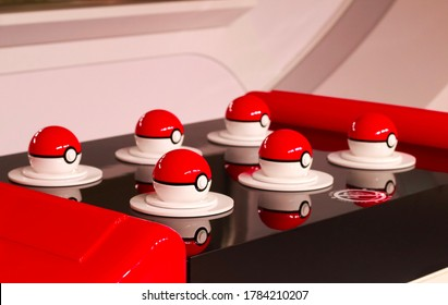 Japan, Tokyo - July 25, 2020 - 6 Pokeballs on a black plate, decoration at the Pokemon Center Mega Tokyo in Japan