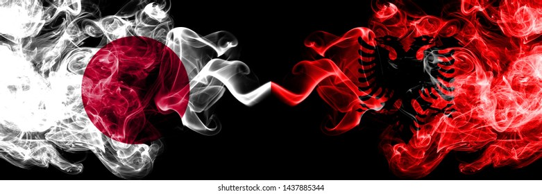 Japan vs Albania, Albanian smoky mystic flags placed side by side. Thick colored silky smokes combination of Albania, Albanian and Japanese flag