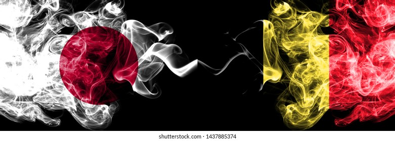 Japan vs Belgium, Belgian smoky mystic flags placed side by side. Thick colored silky smokes combination of Belgium, Belgian and Japanese flag