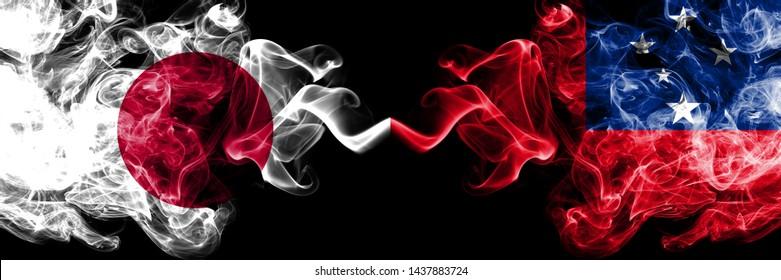 Japan vs Samoa, Samoan smoky mystic flags placed side by side. Thick colored silky smokes combination of Samoa, Samoan and Japanese flag