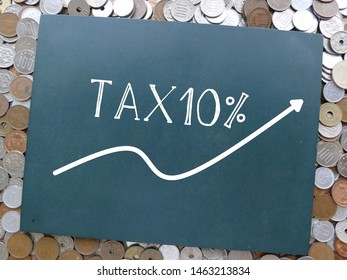 Japan will increase consumption tax to 10% from october 2019. the photo of blackboard on the pile of japanese yen coins.