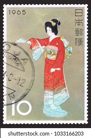 "JAPAN-CIRCA 1965: Canceled Japanese stamp of ""The Prelude"" by Uemura Shoen, a female artist of early 20th-century Japan. The painting captures a dramatic style of Japanese theater called Noh."
