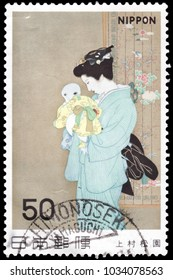 "JAPAN-CIRCA 1965: Canceled Japanese stamp of ""Mother and Child"" by Uemura Shoen, a female artist of early 20th-century Japan. The painting reflects the aesthetic style of Japanese Noh theater."