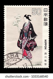 "JAPAN-CIRCA 1980: Canceled Japanese stamp of ""Scenes of Outdoor Play in Spring"" by Sukenobu Nishikawa, an early 18-century Japanese ukiyo-e artist, depicting a noblewoman in lavish kimono robes."