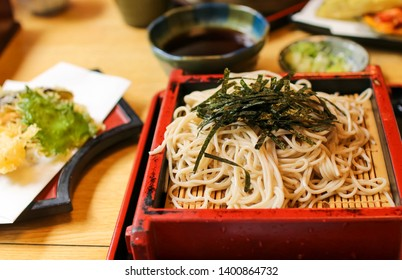Japanes food: cold Jindaiji Soba (buckwheat noodles) with nori on a red tray