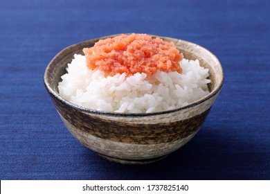 Japanes food, cooked white rice with Karashi mentaiko on table