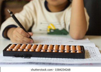 Japanese abacus.Boy counts with abacus in school.