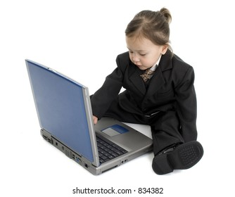Japanese American girl sitting on floor with laptop. Wearing suit.