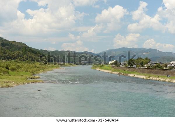 Japanese beautiful blue a fast?flowing  river (Kuma river , Kumamoto,Japan)