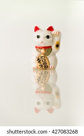 Japanese beckoning cat (Maneki Neko) also means bring wealth to you while a right paw raised, currency sign for you to replace.