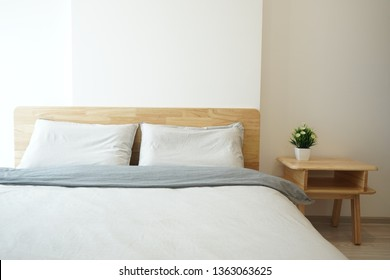 The Japanese bedroom style decorated with wooden and a few simple furniture called Muji style.