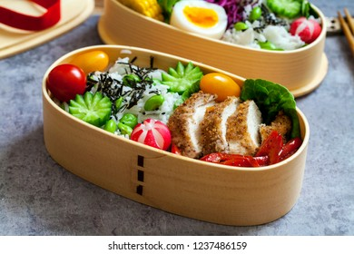 Japanese bento box with chicken, vegetables and rice