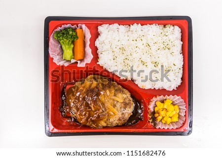 A Japanese Bento Box With Rice Vegetables And Teriyaki Chicken Boxes Are