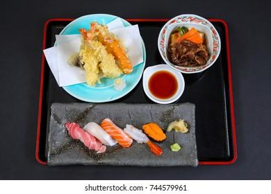 Japanese Bento Box of Tempura, Nigiri Sushi, and Salad