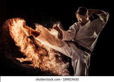 Japanese black belt athlete performing a kick
