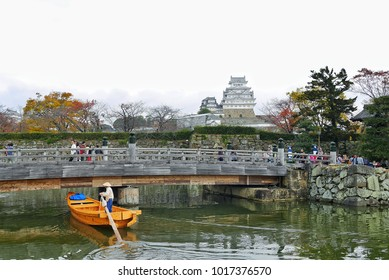 Japanese Boat is riding along the castle moat in front of the Himeji Castle in Hyogo, Himeji, Japan on 20 November 2016