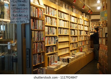 A Japanese book shopkeeper were shelving books at his bookstore in Tokyo, Japan on June 12, 2018