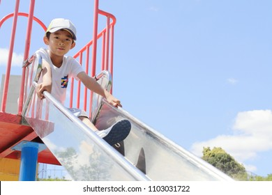 Japanese boy on the slide (third grade at elementary school)