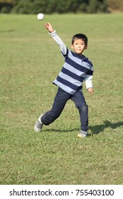 Japanese boy playing catch (second grade at elementary school)