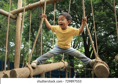 Japanese boy playing at outdoor obstacle course (3 years old)