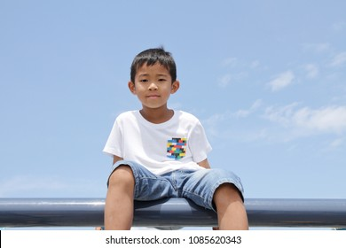 Japanese boy under the blue sky in summer (third grade at elementary school)