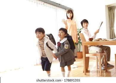 Japanese boys and girls leave for school