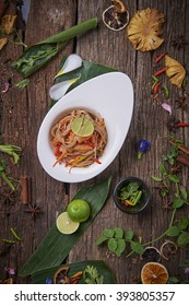 Japanese Buckwheat Noodle Salad topped with Salmon Slices or Salmon Sashimi served with Sliced lemon on Wooden Background