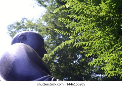 Japanese Buddhist priest, Nichiren statue silhouette at Renjoji Temple, in summer, Kichijoji, Tokyo, Japan