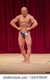 Japanese bulky bald head male 50s bodybuider posing front lat spread