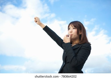 Japanese business woman blowing the whistle