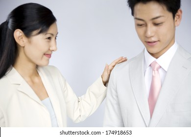 Japanese Business Woman encouraging the junior collegue