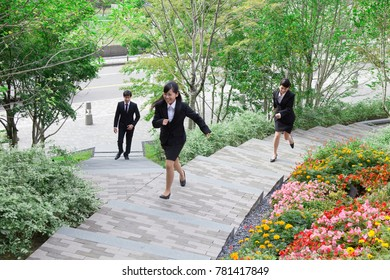 Japanese business woman to run up the stairs