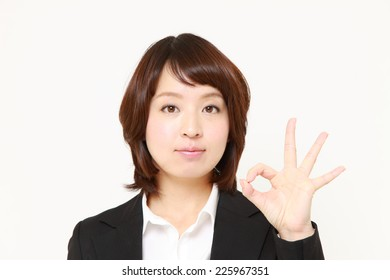 Japanese Business woman showing perfect sign