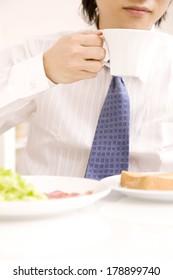 Japanese Businessman drinking coffee