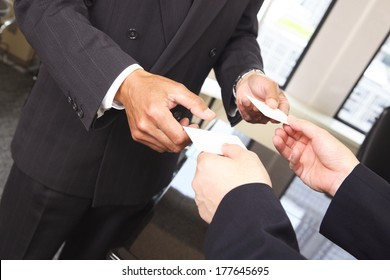 Exchanging business cards images stock photos vectors shutterstock japanese businessman to exchange business cards colourmoves