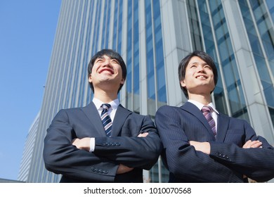 Japanese businessman to his arms folded