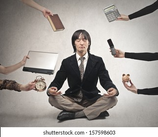 japanese businessman is meditating to relieve stress