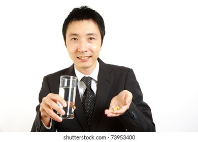 Japanese Businessman takes supplement