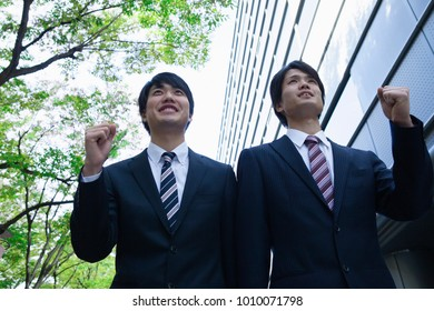 Japanese businessman to victory pose