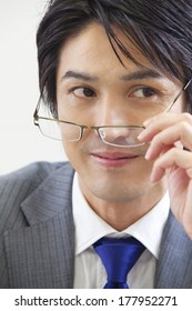 Japanese Businessman who wears glasses