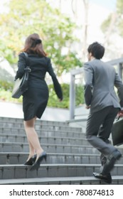 Japanese businessmen and businesswomen to run up the stairs