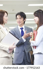 Japanese businesswoman and the businessman talking in an office