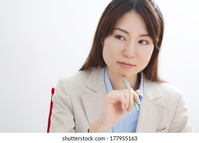 Japanese businesswoman contemplating